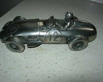rare pewter model of stirling moss in mercedes, his first win at aintree 1955