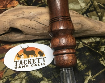 Walnut double reed duck call.