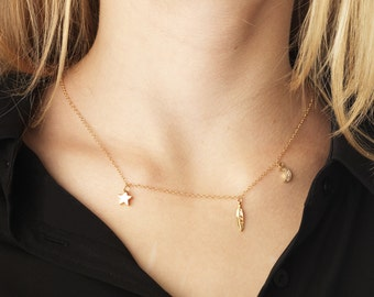 The Choker necklace in gold with star, Moon and feather