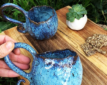 Galaxy blue pottery curly handle mugs