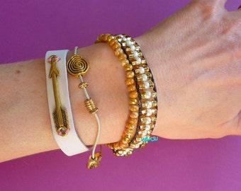 White and gold multi-strand cuff bracelet