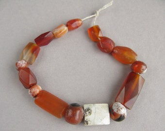 Ancient Carnelian Beads, Natural carnelian beads, V century BC, 5 round beads, 11 faceted beads