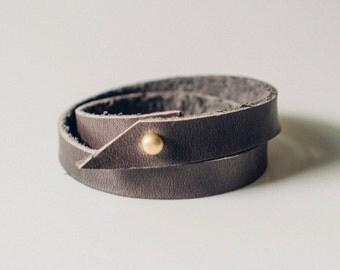 customizable wrap bracelet in graphite grey // Horween Chromexcel leather with a brass push through fastening system // simple and minimal