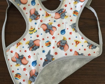 Dumbo reversible Bapron, Bib, 24 months-3T.  Hard for little hands to take off.  Covers a wide coverage for less mess.