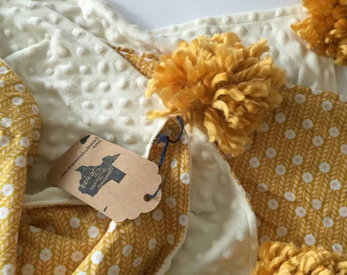 Vintage mustard, cream, and blush pink pom pom blanket