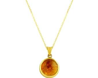 Citrine and gold round pendant