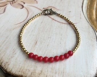Coral and gold-plated brass beads