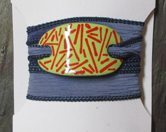 Silk Wrap Yoga Bracelet with Yellow and Red Enamel Slide on a Silk Ribbon