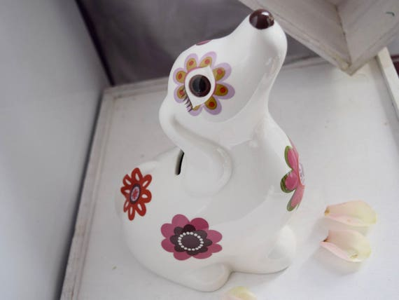 1960s Kitsch Retro floral, money Box, 60s style wide-brown-eyed pooch, piggy bank, savings bank, flower power, retro flowers, hippy style