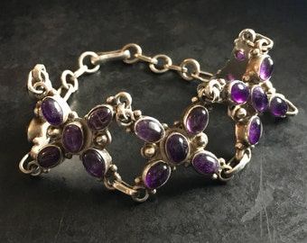 Wide linked bracelet of sterling and amethyst stones. Deep, pretty color!