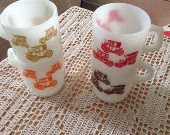 Four Fire King vintage stacking mugs in cars/automobiles pattern, rare find 4 different colors same pattern