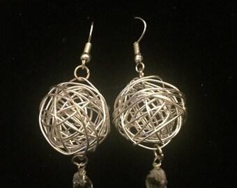 Silver orb earrings with crystal drop detailing.
