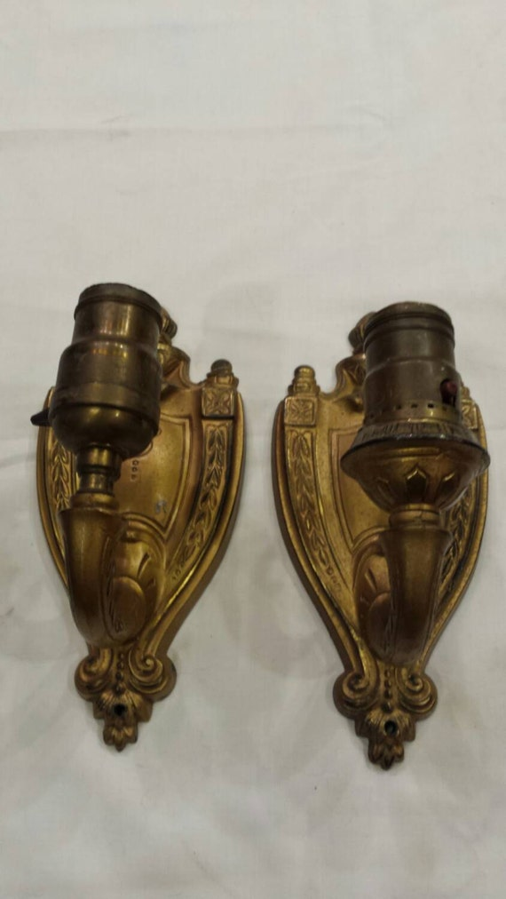 """Vintage Pair of 1930s Brass Wall Sconces.  Each is 3 3/4"""" wide by 8"""" tall.  Both need rewiring.  One has slight damage that can be repaired."""
