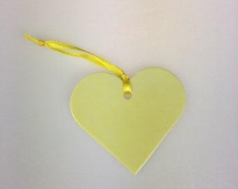 Yellow porcelain heart decoration