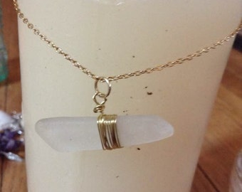 White beach glass pendant wrapped in gold wire