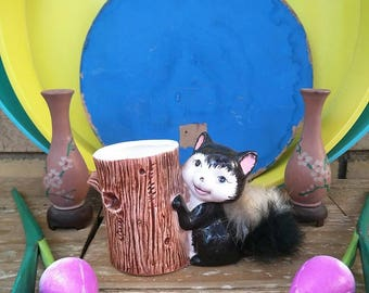 Black Vintage Squirrel/Skunk Holding A Tree Trunk Which Could Hold Pens Ect