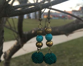 Turquoise knotted drop earrings with antique gold