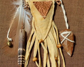 Medicine bag/ Talisman Pouch holding crystal/arrowhead and urchin spine