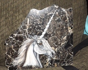 Hand painted  Unicorn on a piece granite