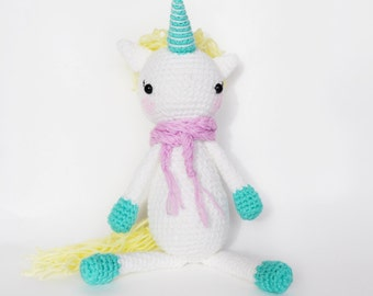 Crochet unicorn toy. Amigurumi unicorn