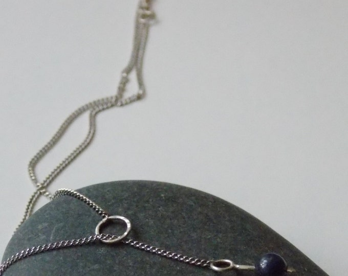 silver lapis necklace. Modern silver chain necklace with a ring hammered effect and a pearl of lapis.