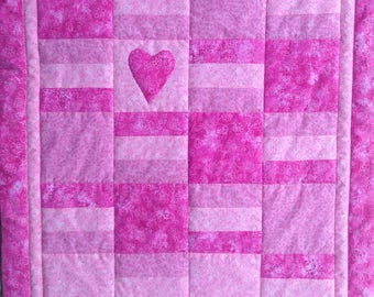 Contemporary pink baby quilt