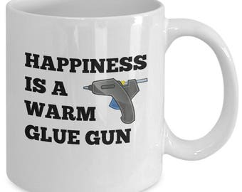 HAPPINESS is a Warm GLUE GUN - Crafter's Mug - Funny Novelty Gift for Crafty People - 11 oz White Coffee Tea Cup