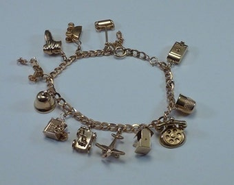 10K Yellow Gold Charm Bracelet with 13 Different Charms, 21.25 grams