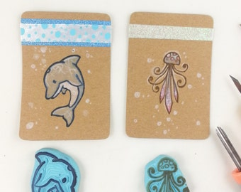 hand carved rubber stamp dolphin and jellyfish handmade stamp for scrapbooking scrapbook ocean water