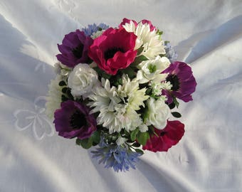 Table arrangement  of seasonal flowers in in a mini metal bucket and a choice of colours ;