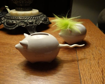 "Two Funny Silly ""BANK Troll"" and ""SPERM Bank"" Money Banks White Ceramic Collectible Piggy Banks"