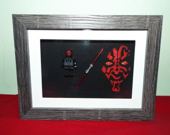 Darth Maul Star Wars Custom Lego figure with lightsaber in a frame