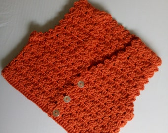 Red coloured Vest hand crocheted,in an eight ply wool and is snug and warm