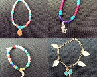 A set of 4 Beaded and Charm bracelets
