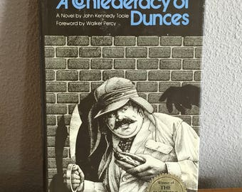 "confederacy of dunces satire The genius of a confederacy of dunces is reaffirmed as successive generations embrace this extravagant satire adulation for toole's comic epic remains as intense today as thirty-five years ago"" (via amazon."