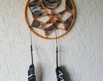 Black and orange dream catcher