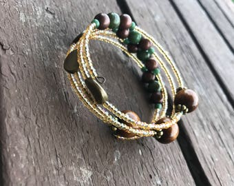 Handmade yellow gold green brown beaded coil wrap around bangle bracelet