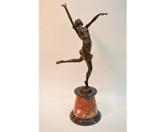 An Art Deco style bronze of a dancing girl, mounted on marbled base 62cm