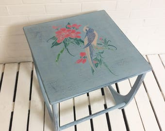 Small bedside coffee table with distressed look vintage style bird stencil print