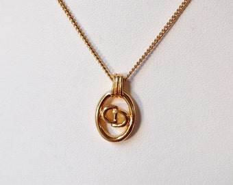 Authentic Christian Dior pattern gold tone necklace.