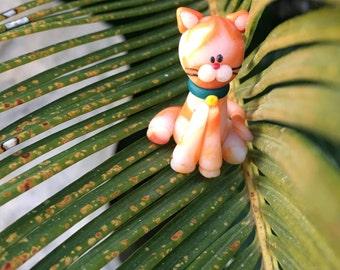 Red cat clay figurine