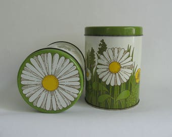 Two tin canister with daisies and yellow retro flowers. Designed by Pat Albeck, England