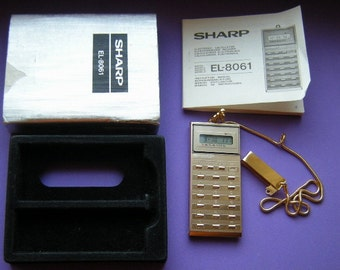 Sharp EL 8061 - mini calculator on chain - Elsi Mate - retro - rare - collectible - Mint