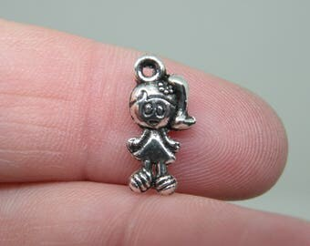 12 Little Girl with a Pony Tail Silver Tone Charms. B-009