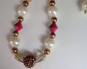 A handmade beaded necklace and earrings set