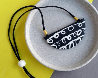 statement necklace, large pendant, graphic squiggle, black and white necklace