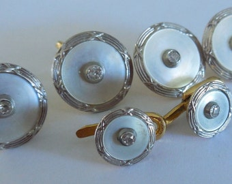 Cuffs + collar buttons. Diamonds, gold, Platinum, mother of Pearl