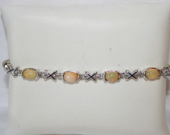 Bracelet in Silver 925 set with real opals