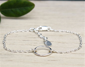 massive silver round ring on chain bracelet