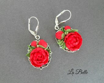 Earrings with polymer clay red piones